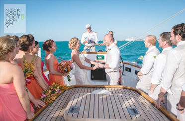 Bride and Groom getting married on a Sailboat in Boston Harbor with Classic Harbor Line