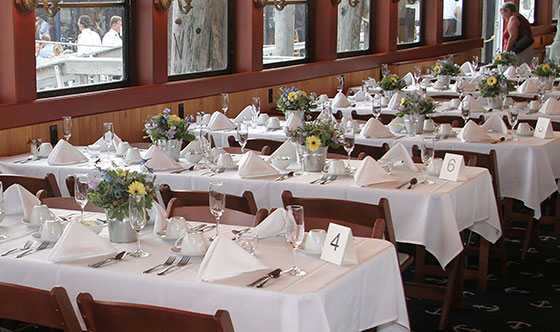 Rehearsal Dinner Set up on yacht Northern Lights in Boston Harbor with Classic Harbor Line
