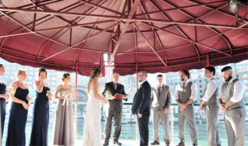 Wedding Ceremony on the top deck of yacht Northern Lights in Boston Harbor